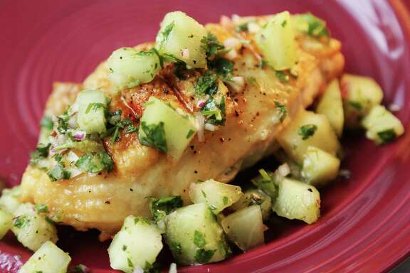 Lime juice, cilantro and serrano pepper balance the sweetness of the honeydew in Grilled Chicken Breasts with Honeydew Salsa.