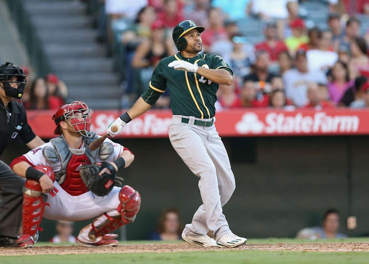 Coco Crisp of the Oakland Athletics hits an RBI double in the seventh inning to give the As a 6-5 lead against the Los Angeles Angels of Anaheim at Angel Stadium of Anaheim on August 4, 2016 in Anaheim, California.