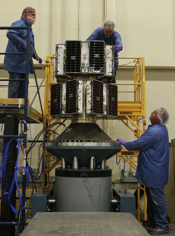 Southwest Research Institute engineering technologists check the new Cyclone Global Navigation Satellite System. Photo: John Davenport / San Antonio Express-News / ©San Antonio Express-News/John Davenport