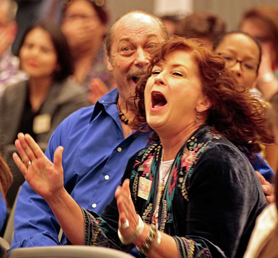 The Texas Pie Company's chef Julie Albertson right, and her husband Spencer Thomas left, react after winning the Grand Prize with her Original Pie Dough Puck in the H-E-B Quest for Texas Best competition finals at the Houston Food Bank Aug. 11, 2016, in Houston. Photo: James Nielsen, Staff / © 2016  Houston Chronicle