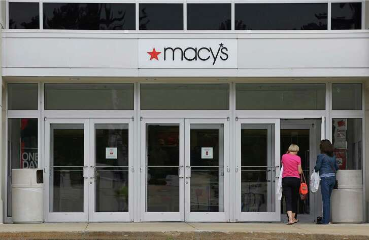 Shoppers enter the   Macy's at the Hanover Mall in Hanover, Mass. The retailer  didn't say  which stores it is planning to close.