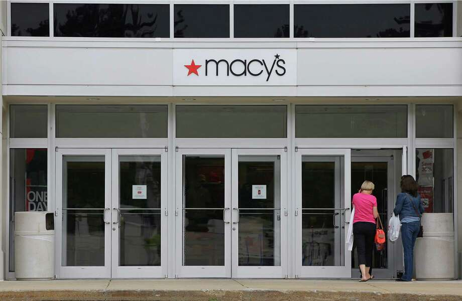 Shoppers enter the   Macy's at the Hanover Mall in Hanover, Mass. The retailer  didn't say  which stores it is planning to close. Photo: Stephan Savoia, STF / Copyright 2016 The Associated Press. All rights reserved. This material may not be published, broadcast, rewritten or redistribu