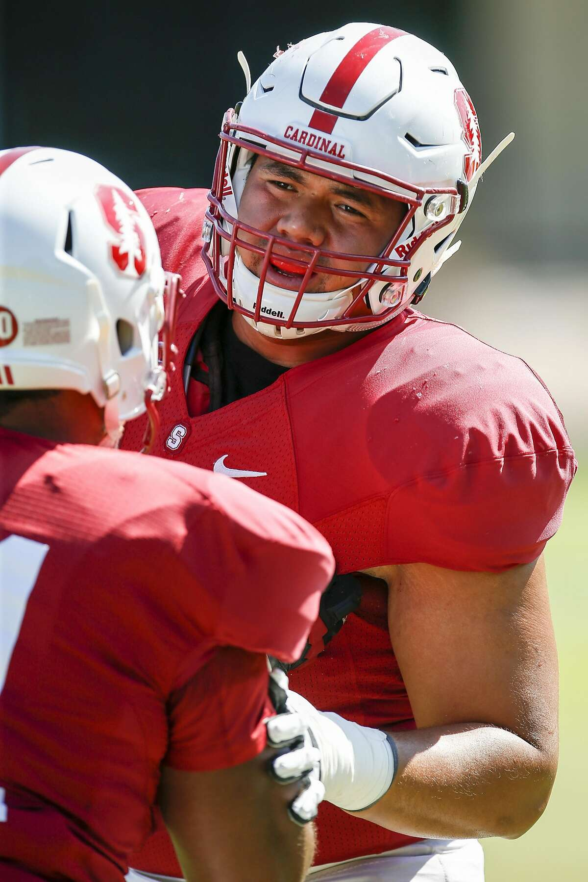 Stanford offensive guard Brandon Fanaika runs through some drills during football practice in Stanford, Calif., Thursday, Aug. 11, 2016.