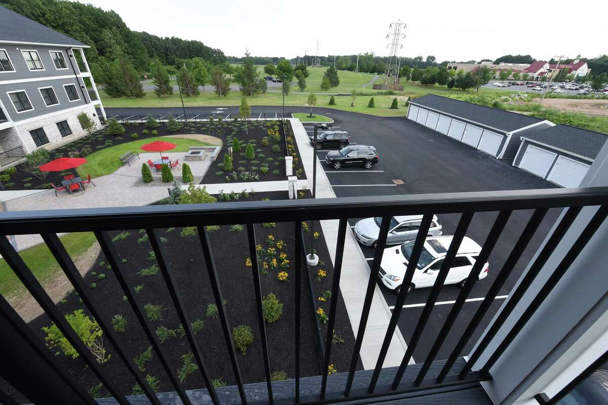 View of the courtyard from a balcony at The Residences at the Crossings on Aviation Road on Thursday, Aug. 11, 2016 in Colonie, N.Y. The Crossings park and The Rudy A. Ciccotti Center, at right, is seen in the distance. (Lori Van Buren / Times Union)