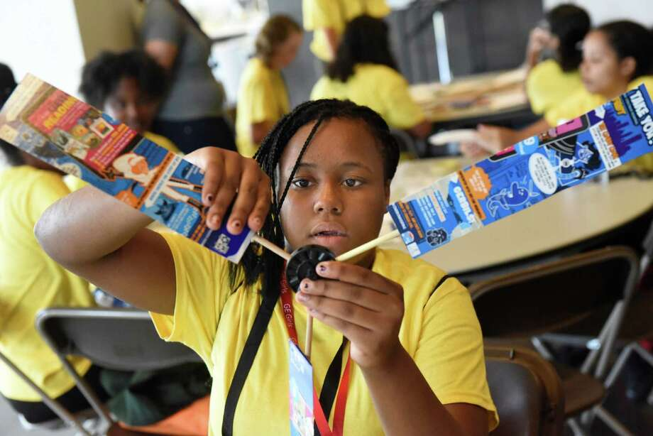 Enid Waring, 13, of Schenectady builds a wind turbine during the 5th annual GE Girls summer STEM experience on Thursday, Aug. 11, 2016, at General Electric in Schenectady, N.Y. (Cindy Schultz / Times Union) Photo: Cindy Schultz / Albany Times Union