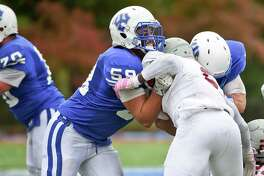 Michael LaSala of Wilton, left, a senior offensive lineman at Washington & Lee, has been named a Division III All-American this fall prior to the upcoming season.