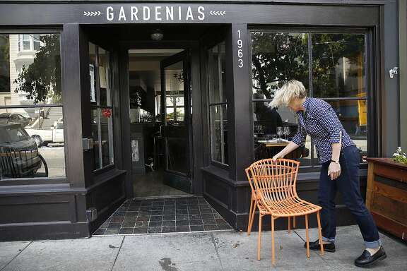 Gardenias co-owner Margie Conrad, of Woodward's Garden for 22 years, prepares the restaurant for dinner in the Fillmore on Thursday, August 11, 2016, in San Francisco, Calif.