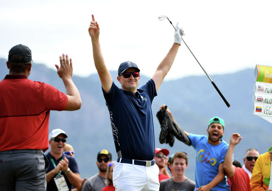 Great Britain's Justin Rose savors his hole-in-one on the par-4 fourth hole during the first round. Photo: Ross Kinnaird / Getty Images / 2016 Getty Images