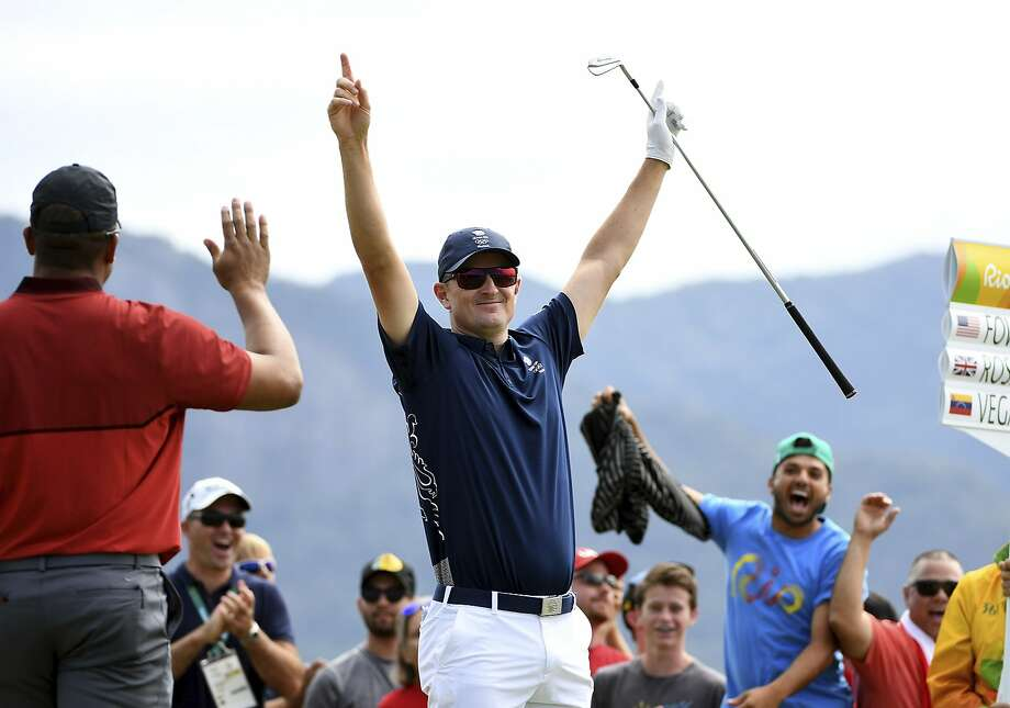 Justin Rose of Great Britain celebrates his hole-in-one on the par four 4th hole during the first round of men's golf on Day 6 of the Rio 2016 Olympics at the Olympic Golf Course on August 12, 2016 in Rio de Janeiro, Brazil. Photo: Ross Kinnaird, Getty Images