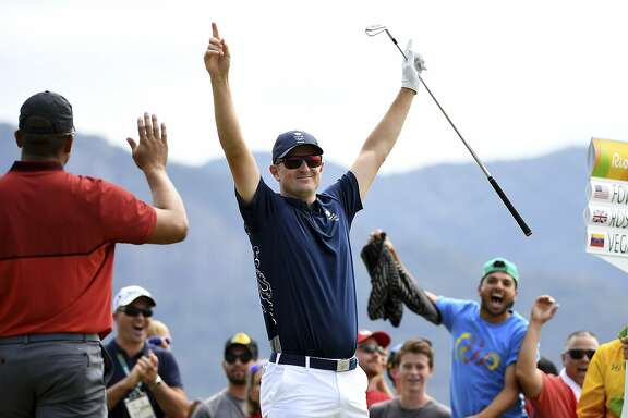 RIO DE JANEIRO, BRAZIL - AUGUST 11:  Justin Rose of Great Britain celebrates his hole-in-one on the par four 4th hole during the first round of men's golf on Day 6 of the Rio 2016 Olympics at the Olympic Golf Course on August 12, 2016 in Rio de Janeiro, Brazil.  (Photo by Ross Kinnaird/Getty Images)