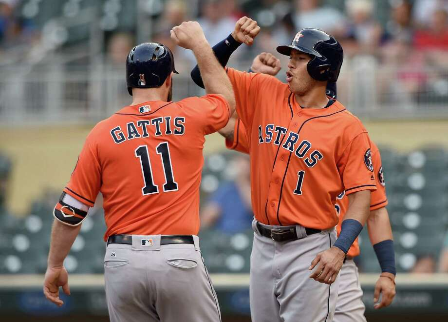 MINNEAPOLIS, MN - AUGUST 11: Carlos Correa #1 of the Houston Astros congratulates teammate Evan Gattis #11 on a three-run home run against the Minnesota Twins during the second inning of game two of a doubleheader on August 11, 2016 at Target Field in Minneapolis, Minnesota. Photo: Hannah Foslien, Getty Images / 2016 Getty Images