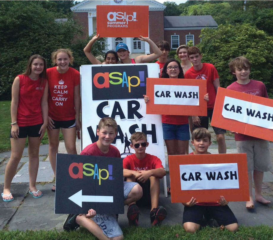 The After School Arts Program based in Washington recently played host to a car wash to raise funds for its August summer camp. Among the youths who helped with the event are, from left to right, in front, Noah Pote, Logan Pacific and Liam Pacific, and in back, Charlotte Hopkins-Smith, Meghan Bottino, Alyssa Dhalla, Bailey Pote, Wilson King, Harlequin Sullivan, Bridget Snyder, Thomas Bachelier and Wyatt King. Photo: Courtesy Of ASAP / The News-Times Contributed