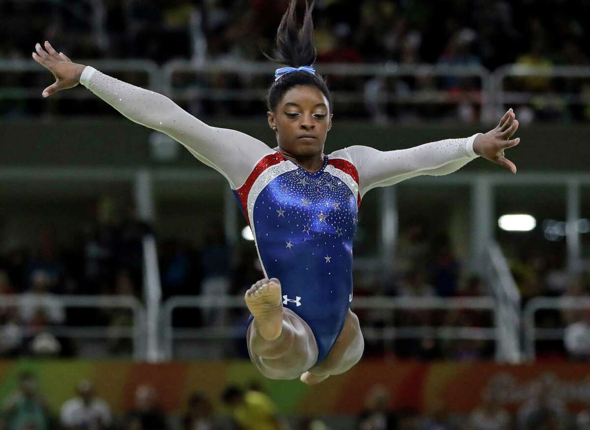 United States' Simone Biles performs on the balance beam during the artistic gymnastics women's individual all-around final at the 2016 Summer Olympics in Rio de Janeiro, Brazil, Thursday, Aug. 11, 2016. (AP Photo/Dmitri Lovetsky) ORG XMIT: OGYM230