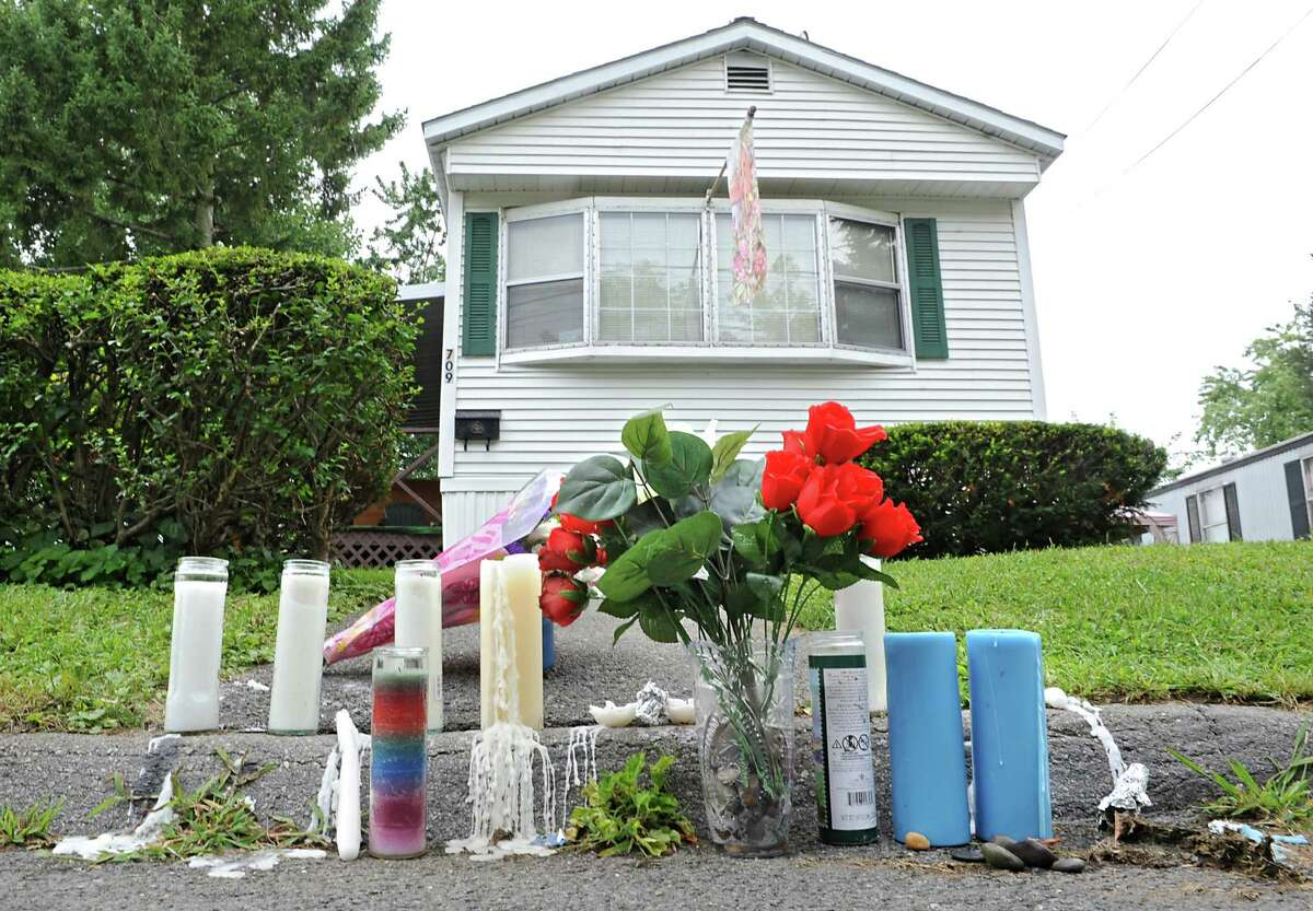 Flowers and candles are left outside the home of Michael Allen and Marie Lockrow on Thursday, Aug. 21, 2014, in Troy, N.Y. (Lori Van Buren / Times Union archive)