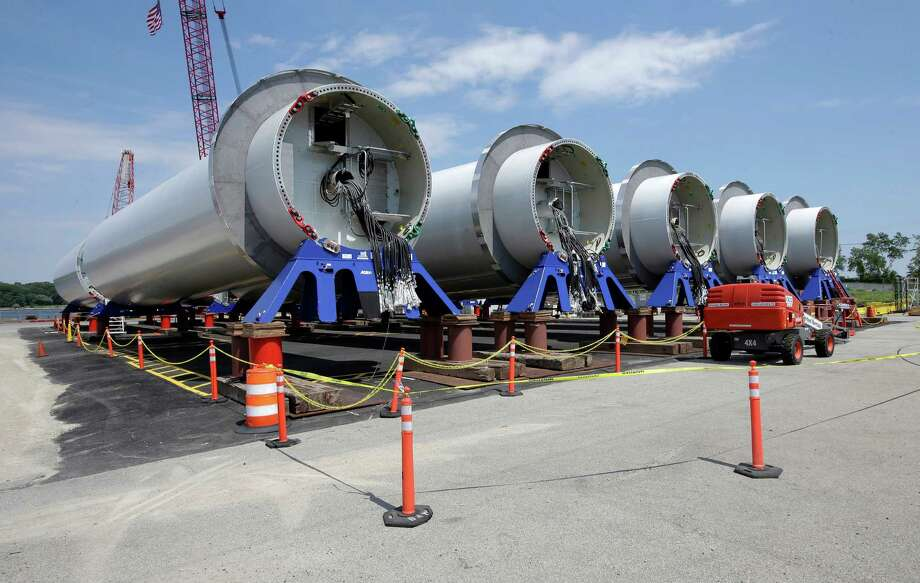 Sections of wind turbine towers sit at a staging site at Port of Providence Deepwater Wind.  Click through to see recent U.S. energy consumption by type.  Photo: Steven Senne, STF / Copyright 2016 The Associated Press. All rights reserved. This material may not be published, broadcast, rewritten or redistribu
