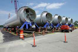 Sections of wind turbine towers sit at a staging site at Port of Providence Deepwater Wind. The U.S. is taking bids for a Carolina coast wind farm.