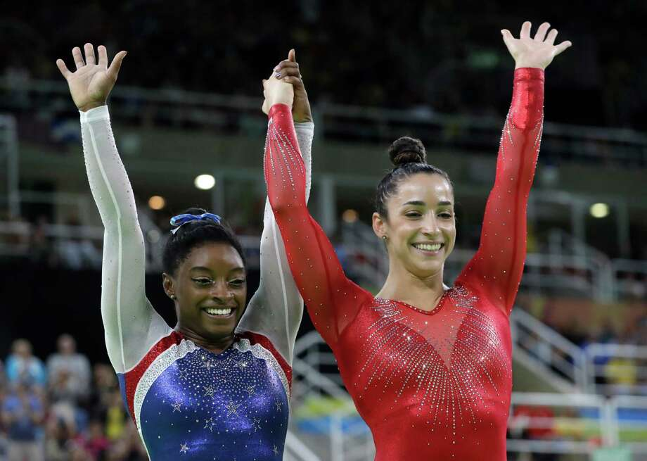 United States' Simone Biles, left, and Aly Raisman celebrate after winning gold and silver respectively for the artistic gymnastics women's individual all-around final at the 2016 Summer Olympics in Rio de Janeiro, Brazil, Thursday, Aug. 11, 2016. Photo: Dmitri Lovetsky /Associated Press / Copyright 2016 The Associated Press. All rights reserved. This material may not be published, broadcast, rewritten or redistribu