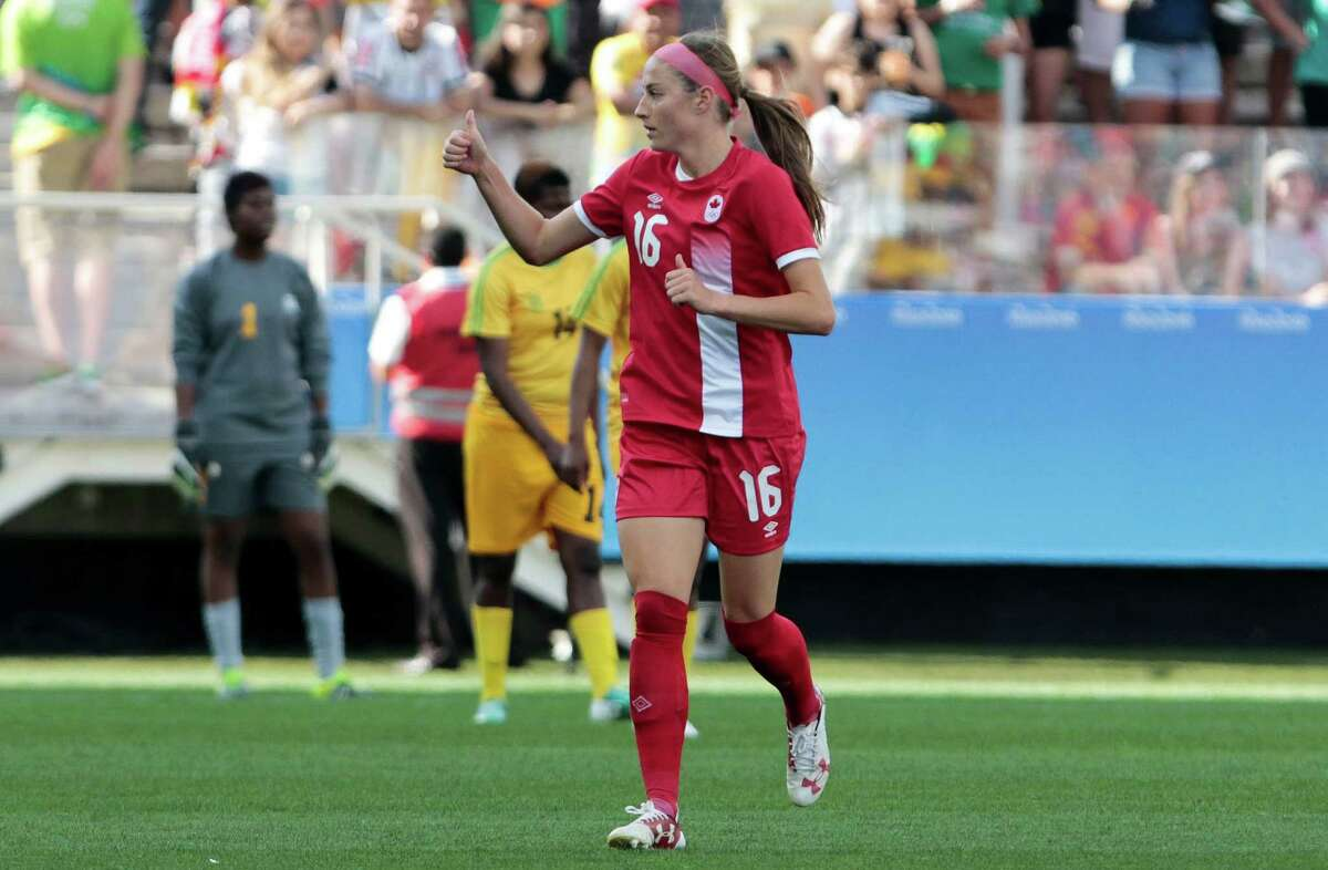 Janine Beckie (R) of Canada, celebrates after scoring against Zimbabwe, during their Rio 2016 Olympic Games Second Round Group F women's football match at the Corinthians Arena, in Sao Paulo, Brazil, on August 6, 2016. / AFP PHOTO / Miguel SCHINCARIOLMIGUEL SCHINCARIOL/AFP/Getty Images