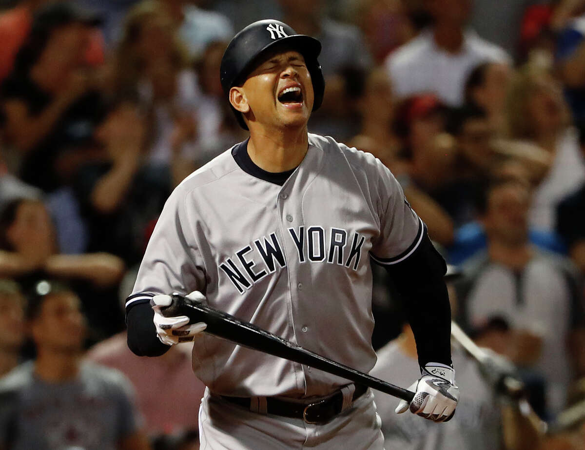 New York Yankees' Alex Rodriguez reacts to flying out as a pinch hitter during the seventh inning of a baseball game against the Boston Red Sox at Fenway Park in Boston on Wednesday, Aug. 10, 2016. (AP Photo/Winslow Townson) ORG XMIT: BXF116
