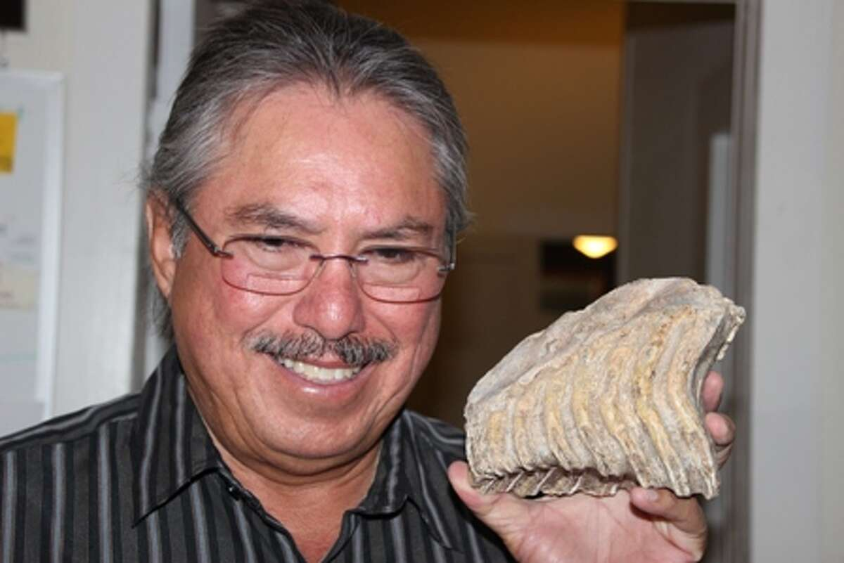 Henry Gutierrez Jr. smiles as he shows one of his many fossils in this photo taken in May 2015. Gutierrez, who grew up on the family farm in Schertz, was killed by an unknown assailant(s) Dec. 24, 2015.