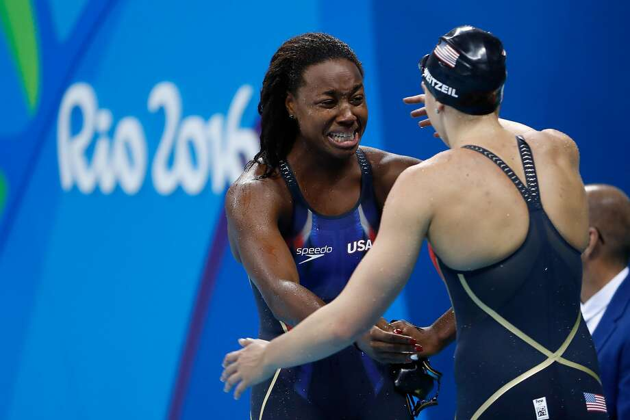 RIO DE JANEIRO, BRAZIL - AUGUST 11:  Simone Manuel of the United States embraces Abbey Weitzeil of the United States after winning gold in the Women's 100m Freestyle Final on Day 6 of the Rio 2016 Olympic Games at the Olympic Aquatics Stadium on August 11, 2016 in Rio de Janeiro, Brazil.  (Photo by Clive Rose/Getty Images) Photo: Clive Rose, Getty Images