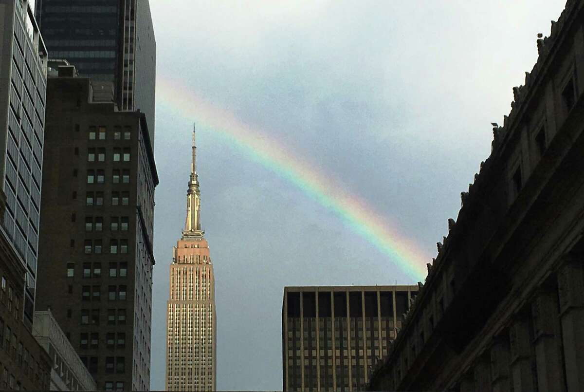 A rainbow appears over the Empire State Building after afternoon showers Thursday, Aug. 11, 2016, in New York. High temperatures are expected to top 90 degrees in New York City through Sunday. (AP Photo/Daniel P. Derella) ORG XMIT: NYDD201