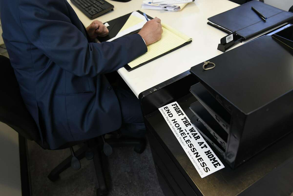 A bumper sticker sits on a desk nearJeff Kositsky, director of the Department of Homelessness and Supportive Housing, during his meeting with Leon Winston and Michael Blecker of Swords to Plowshares, at the DHSH offices in San Francisco, CA Thursday, August 11th, 2016.