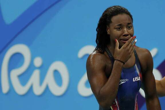 Simone Manuel swam into history in Rio as she became the first African-American to win the women's 100-meter freestyle.