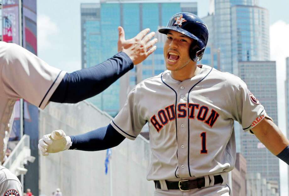 Houston Astros' Carlos Correa celebrates his three-run home run off Minnesota Twins pitcher Buddy Boshers in the fifth inning of a baseball game Thursday, Aug. 11, 2016 in Minneapolis. (AP Photo/Jim Mone) Photo: Jim Mone, STF / Copyright 2016 The Associated Press. All rights reserved. This material may not be published, broadcast, rewritten or redistribu