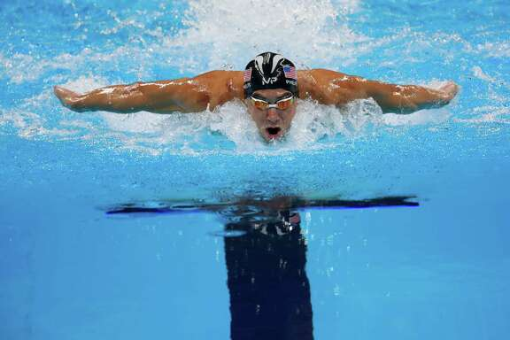 Michael Phelps captures the 200-meter individual medley Thursday for his 22nd Olympic gold medal. His anticipated showdown with fellow American Ryan Lochte didn't materialize as Lochte faded to finish fifth.