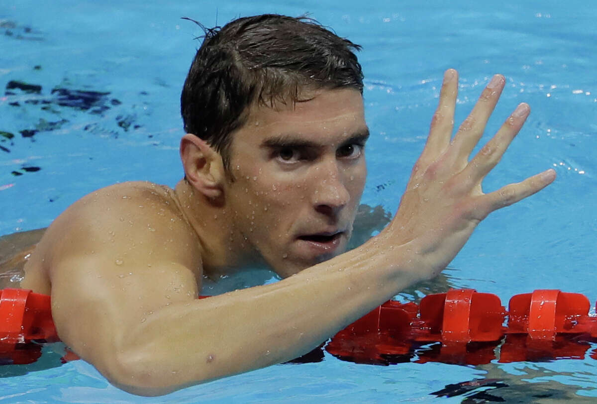 United States' Michael Phelps celebrates winning gold in the men's 200-meter individual medley during the swimming competitions at the 2016 Summer Olympics, Thursday, Aug. 11, 2016, in Rio de Janeiro, Brazil. (AP Photo/Natacha Pisarenko) ORG XMIT: OSWM549