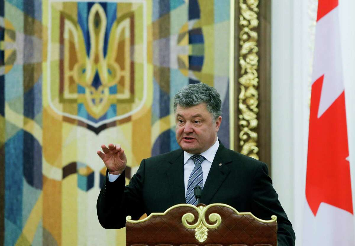 FILE - In this file photo dated Monday, July 11, 2016, Ukrainian President Petro Poroshenko gestures during a news conference in Kiev, Ukraine. In a statement Thursday Aug. 11, 2016, Ukrainian President Poroshenko says he has ordered the army to be put on combat alert on the de-facto border with Crimea and the line of contact in eastern Ukraine, in response to relations with Russia. (AP Photo/Efrem Lukatsky, FILE) ORG XMIT: LRC105