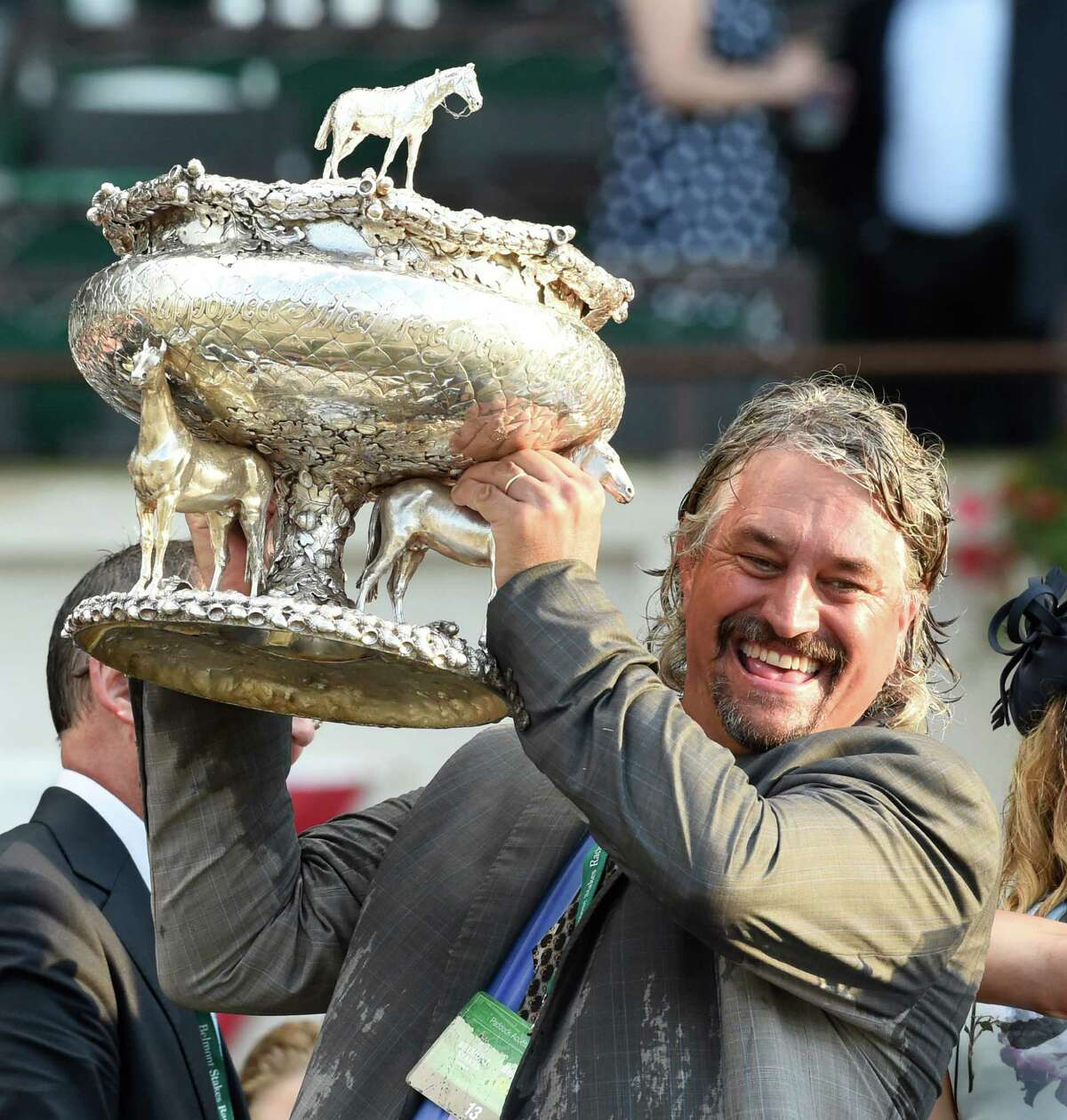 Creator's trainer Steve Asmussen holds the winner's trophy up after winning the 148th running of The Belmont Stakes with Creator on Saturday, June 11, 2016, in Elmont, N.Y. (Skip Dickstein/Times Union)