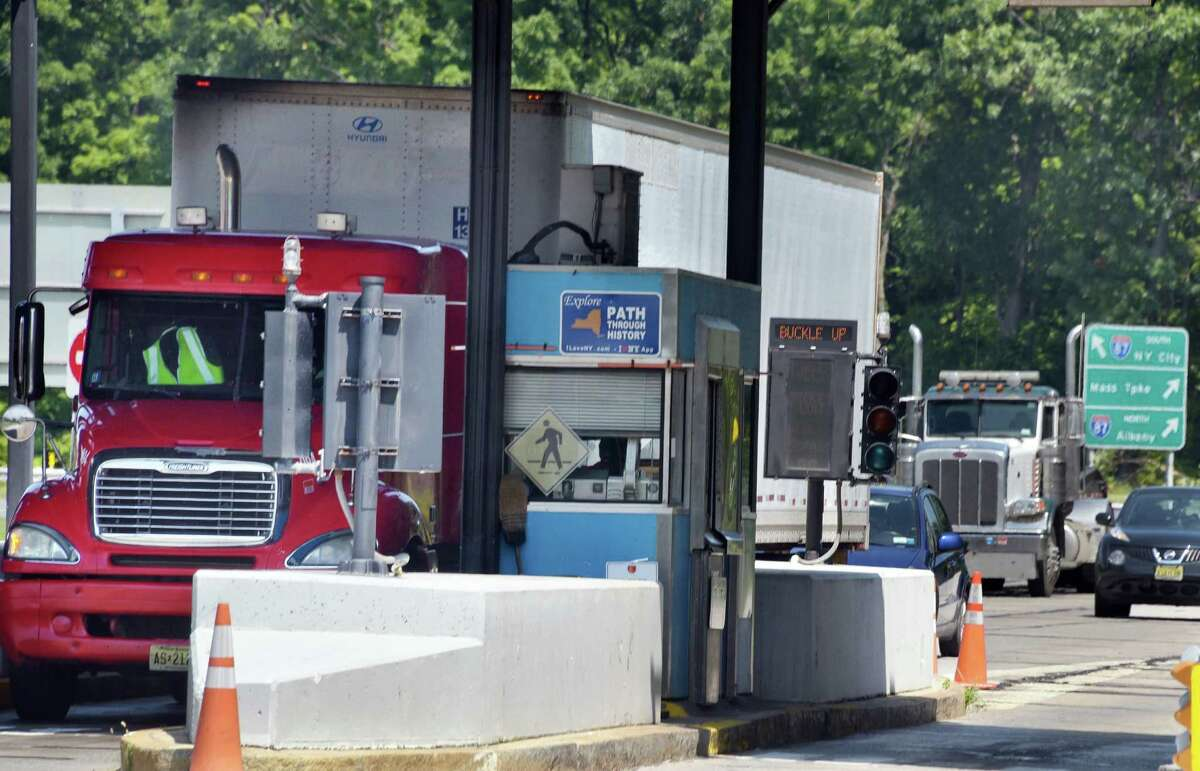 Trucks exit the NYS Thruway at Exit 21, Thursday Aug. 11, 2016 in Catskill, NY. (John Carl D'Annibale / Times Union)