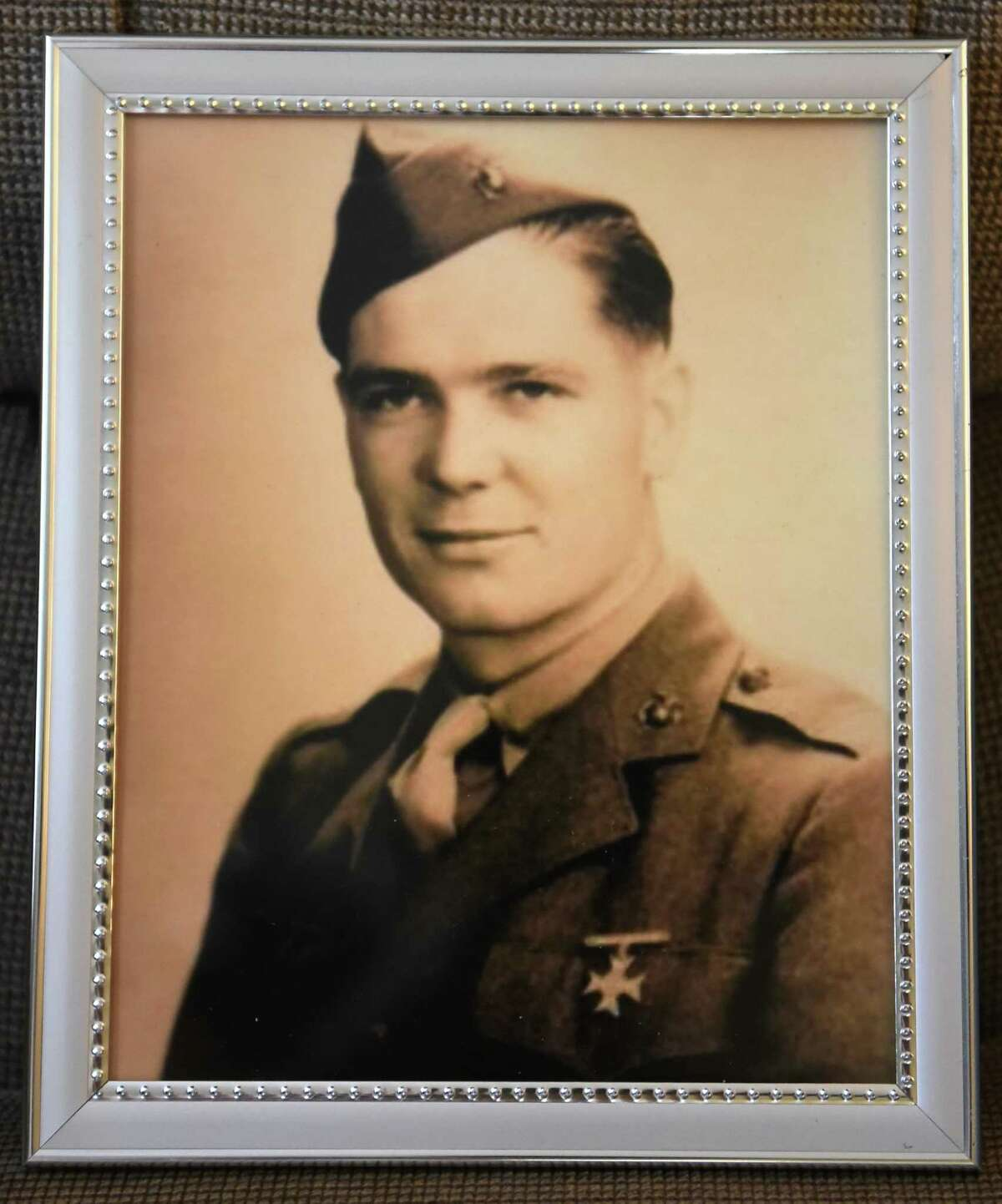 Photo of George Traver, a World War II Marine who was killed in combat against the Japanese on Nov. 20, 1943 at the Battle of Tarawa Wednesday, Aug. 10, 2016 in Chatham, N.Y. His remains were found in May, identified by the pocketknife his parents had given to him. His remains will arrive at Albany International Airport on Aug. 26 and will be taken by motorcade to his hometown of Chatham, where there will be a service and interment over the weekend. (Lori Van Buren / Times Union)