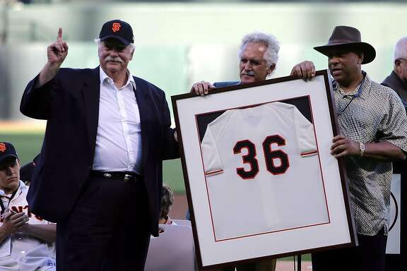 Former San Francisco Giants player Gaylord Perry, second from left, is joined by former teammates Mike McCormick, center, and Orlando Cepeda in a ceremony retiring Perry's number before the start of a game against the Florida Marlins, Saturday, July 23, 2005, in San Francisco. (AP Photo/Marcio Jose Sanchez)  Ran on: 07-24-2005 Perry  ALSO Ran on: 10-24-2006 Gaylord Perry thinks Kenny Rogers should switch to North Carolina pine tar  --  &quo;It's clean.&quo; Ran on: 10-24-2006 Gaylord Perry thinks Kenny Rogers should switch to North Carolina pine tar.  Ran on: 11-22-2009 Gaylord Perry Ran on: 11-22-2009 Gaylord Perry