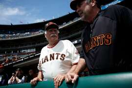 Former San Francisco Giants pitcher Gaylord Perry, left, shares a conversation with manager Bruce Bochy during the Giants Legends game at AT&T Park in San Francisco, Calif., Saturday, June 11, 2011.
