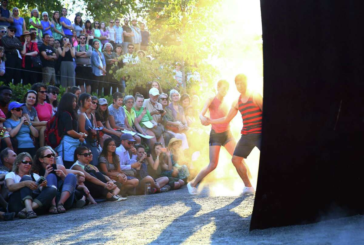 Pacific Northwest Ballet dancers James Moore and Leah Merchant perform Do. Not. Obstruct., choreographed by Kiyon Gaines, during Sculptured Dance, a SAM event at the Olympic Sculpture Park, Thursday, Aug, 11, 2016.
