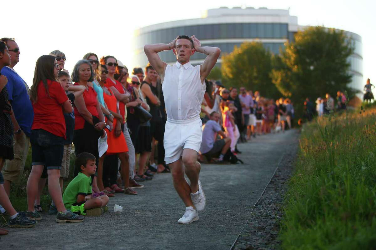 Whim W'Him dancer Patrick Kilbane performs Little Bunnies, choreographed by Kate Wallich, during Sculptured Dance, a SAM event at the Olympic Sculpture Park, Thursday, Aug, 11, 2016.