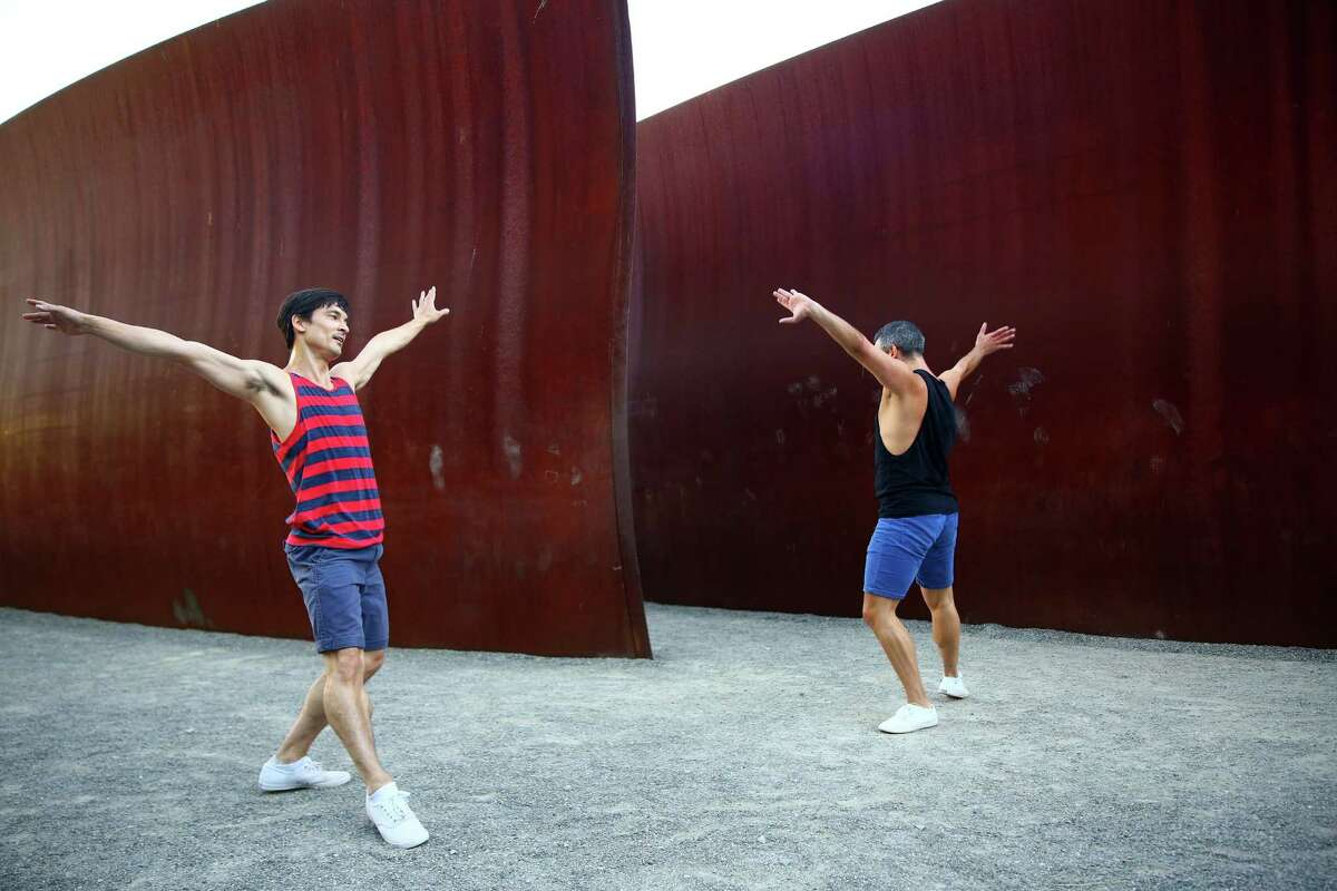Pacific Northwest Ballet dancers James Moore, left, and Jonathan Porretta perform Do. Not. Obstruct., choreographed by Kiyon Gaines, during Sculptured Dance, a SAM event at the Olympic Sculpture Park, Thursday, Aug, 11, 2016.