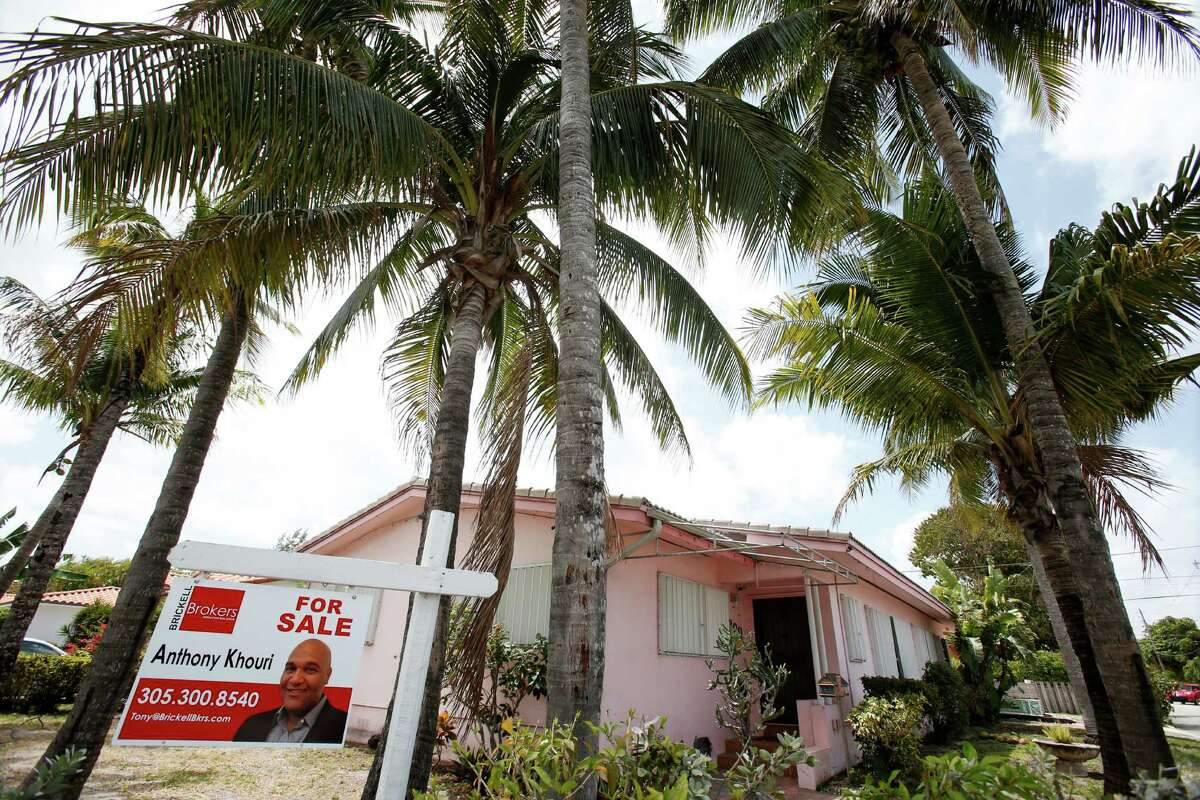 This Monday, April 11, 2016, photo shows a home for sale in Surfside, Fla. On Thursday, Aug. 11, Freddie Mac reports on the week's average U.S. mortgage rates. (AP Photo/Wilfredo Lee) ORG XMIT: NYBZ406