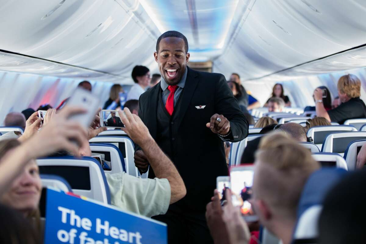 Southwest Airlines recently celebrated its new uniforms and interior during an in-flight fashion show at 35,000 feet. (Stephen M. Keller)