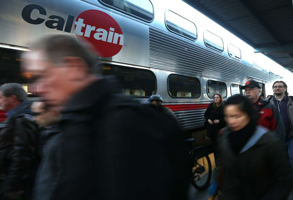 Commuters arrive at the Caltrain station on Fourth and King streets in San Francisco.