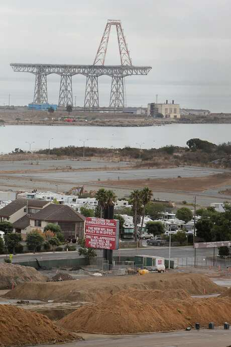 Part of the site of the Candlestick Point project in the foreground is seen with the crane from the former Hunters Point Naval Shipyard in the background. Photo: Lea Suzuki, The Chronicle