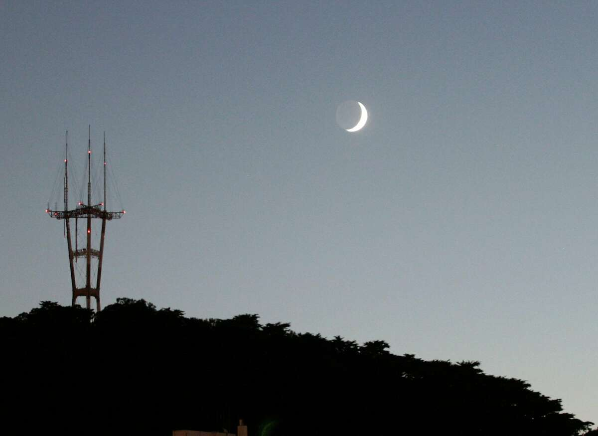 In this file photo, Sutro Tower is seen on top of Twin Peaks at sunset in San Francisco.