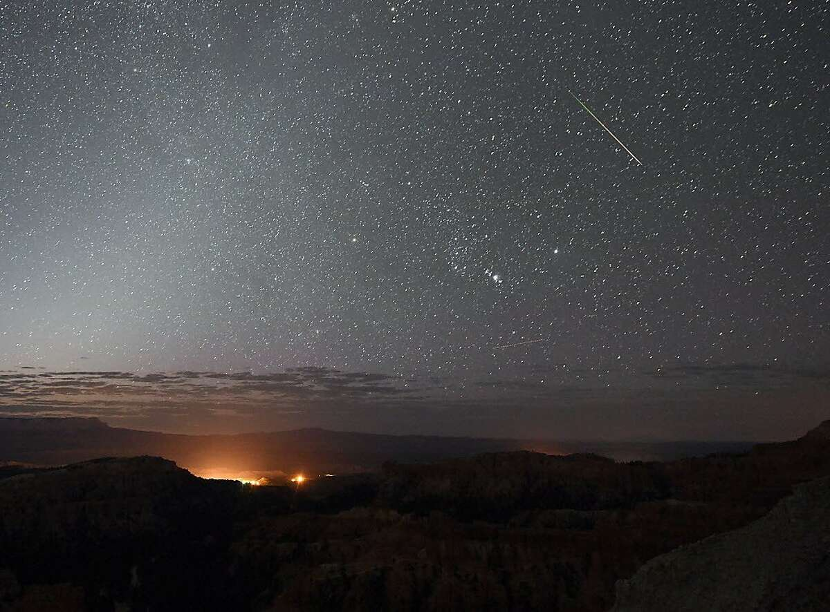 A Perseid meteor streaks across the sky above Inspiration Point early on August 12, 2016 in Bryce Canyon National Park, Utah. The annual display, known as the Perseid shower because the meteors appear to radiate from the constellation Perseus in the northeastern sky, is a result of Earth's orbit passing through debris from the comet Swift-Tuttle.