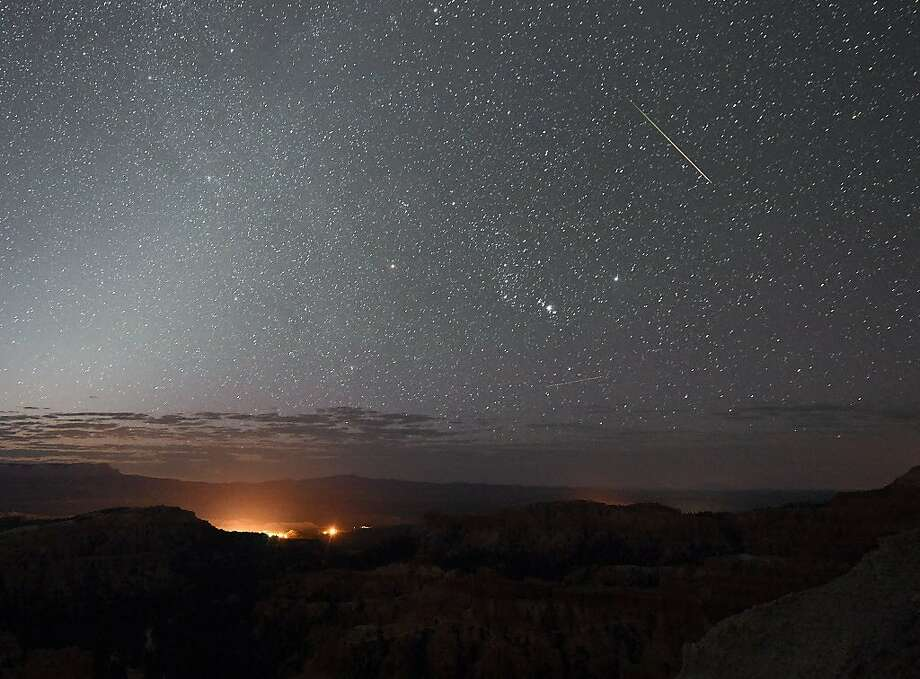 A Perseid meteor streaks across the sky above Inspiration Point early on August 12, 2016 in Bryce Canyon National Park, Utah. The annual display, known as the Perseid shower because the meteors appear to radiate from the constellation Perseus in the northeastern sky, is a result of Earth's orbit passing through debris from the comet Swift-Tuttle. Photo: Ethan Miller, Getty Images