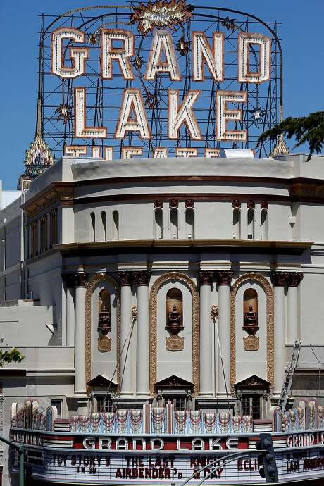 The Grand Lake theater has recently been repainted and fixed up in its' prominent place on Grand Avenue. Photo: Brant Ward, The Chronicle