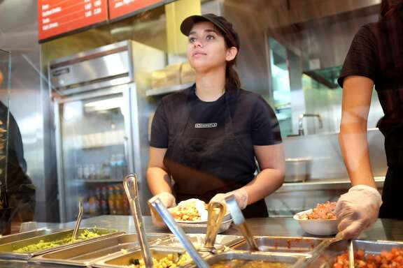 MIAMI, FL - MARCH 05:  A restaurant worker fills an order at a Chipotle restaurant on March 5, 2014 in Miami, Florida. The Mexican fast food chain is reported to have tossed around the idea that it would temporarily suspend sales of guacamole due to an increase in food costs.  (Photo by Joe Raedle/Getty Images)