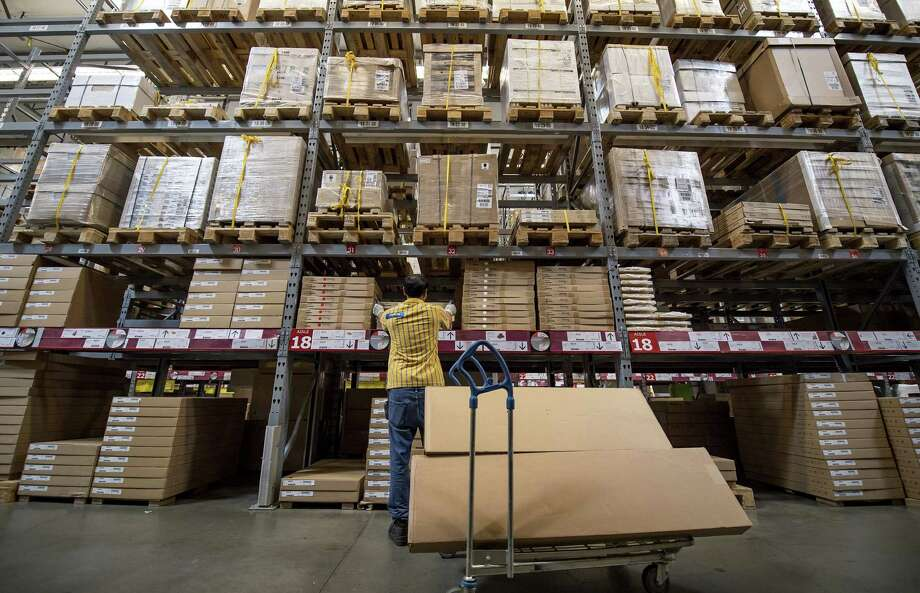An employee puts a box on a shelf inside an Ikea in Emeryville, California. In July, retailers reduced stockpiles by 0.3 percent and sSales were up a slight 0.1 percent in July. Overall business inventories were flat while sales dropped 0.1 percent. Photo: David Paul Morris /Bloomberg News / © 2016 Bloomberg Finance LP